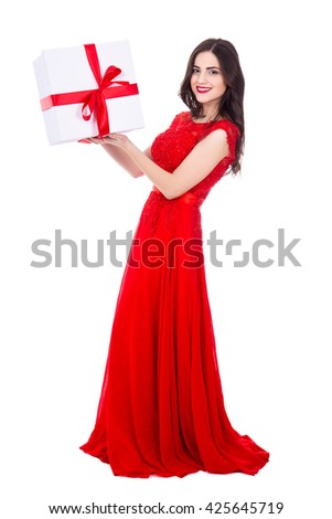 full length portrait of young beautiful woman in red dress with big gift box isolated on white background - stock photo