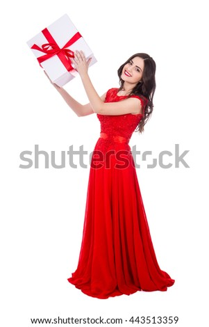 full length portrait of young beautiful woman in red dress with gift box isolated on white background - stock photo