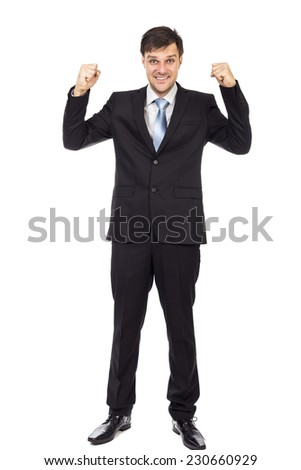Full length portrait of young business man enjoying success isolated on white background - stock photo