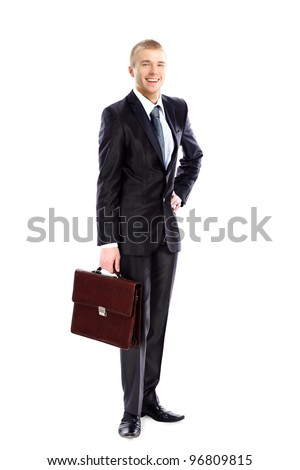 Full length portrait of young business man holding briefcase in hand isolated on white