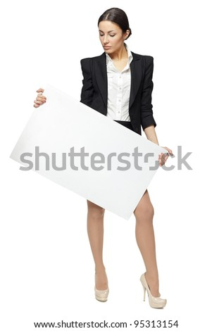 Full length portrait of young business woman holding the blank board, looking at the blank copy space on the board, isolated on white background