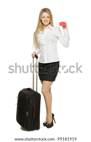 Full length portrait of young business woman standing with black travel bag holding empty credit card, isolated on white background - stock photo