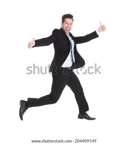 Full length portrait of young businessman running while gesturing thumbs up over white background