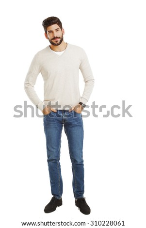 Full length portrait of young businessman standing against white background while looking at camera and smiling.  - stock photo