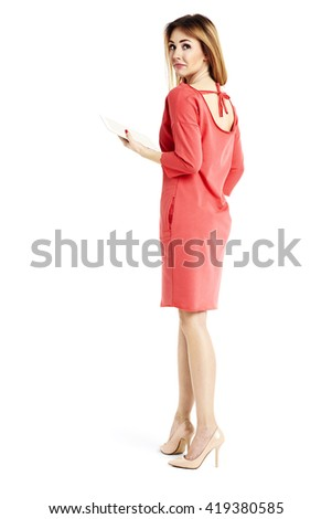 Full length portrait of young businesswoman looking over her shoulder. - stock photo