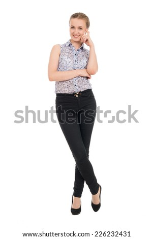 Full length portrait of young businesswoman smiling isolated on white background - stock photo