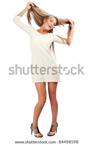 Full length portrait of young cheerful woman pulling her hair, against white background - stock photo