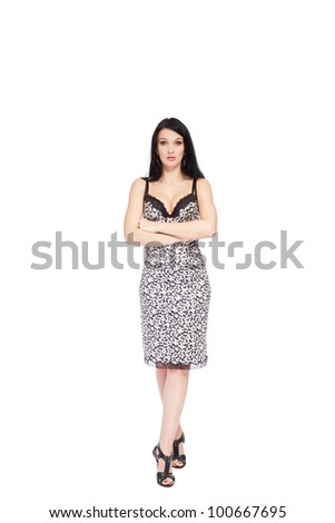 Full length portrait of young fashion woman in dress smiling, posing isolated over white background