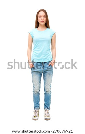 Full length portrait of young girl in casual clothing isolated on white background.