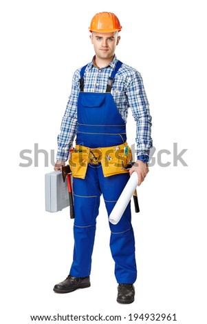 Full length portrait of young male construction worker with toolbox and drawings, wearing protective clothes, helmet and tool belt isolated on white background - stock photo