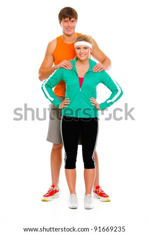 Full length portrait of young man and healthy girl in sportswear isolated on white - stock photo