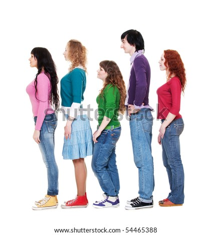 full length portrait of young man and women in queue against white background - stock photo