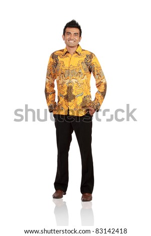 Full length portrait of young man standing with hands in pockets over white background - stock photo