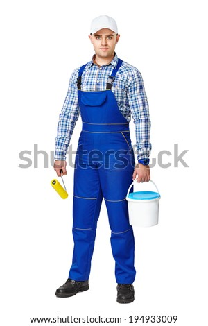 Full length portrait of young painter with paint and brush ready to work isolated on white background