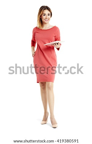 Full length portrait of young smiling businesswoman holding a digital tablet. - stock photo