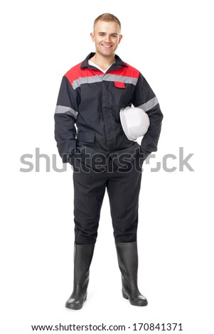 Full length portrait of young smiling engineer holding white helmet isolated on white background