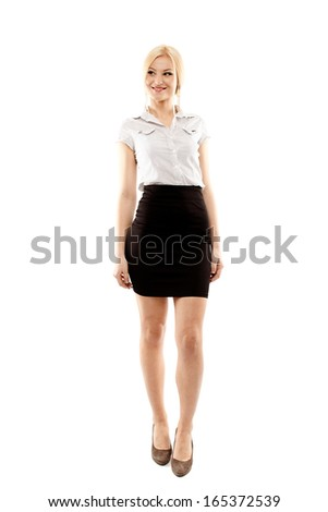Full length portrait of young successful businesswoman smiling, isolated over white background - stock photo