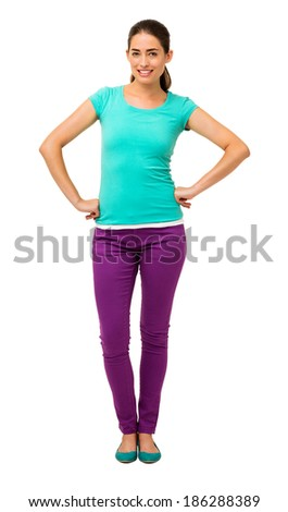 Full length portrait of young woman in casuals standing with hands on hips isolated over white background. Vertical shot. - stock photo