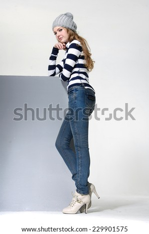 full-length portrait of young woman in hat standing posing - stock photo