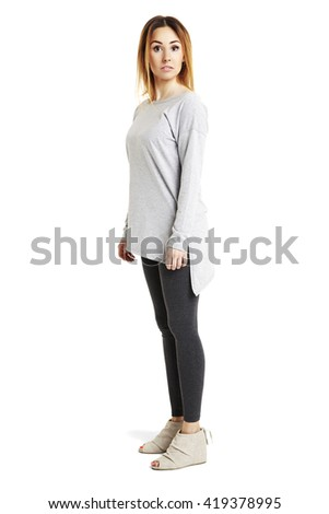 Full length portrait of young woman looking at camera. Studio shot. Isolated on white background.  - stock photo