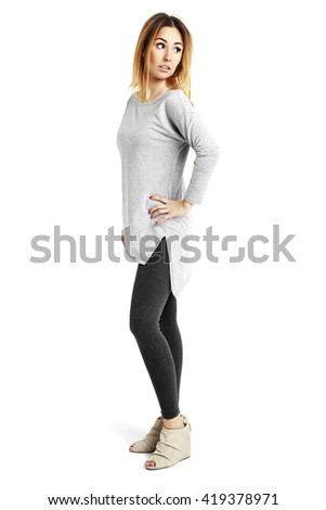 Full length portrait of young woman looks over her shoulder.  - stock photo