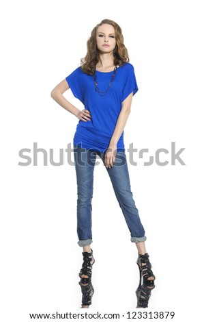 Full length portrait of young woman posing on white background - stock photo