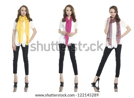 full length portrait of young woman with scarf standing posing - stock photo