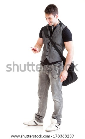 Full length portrait school boy phone isolated on white