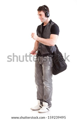 Full length portrait school boy phone isolated on white listening to music