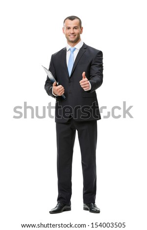 Full-length portrait thumbing up businessman with folder, isolated on white. Concept of leadership and success