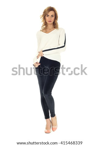 Full-length portrait young woman in pants isolated