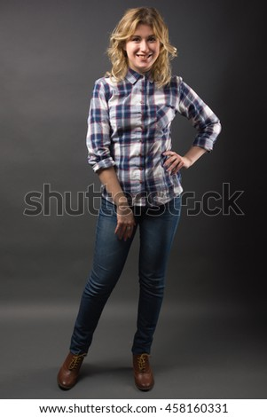 Full length Pretty casual young fashion model in blue jeans posing. - stock photo