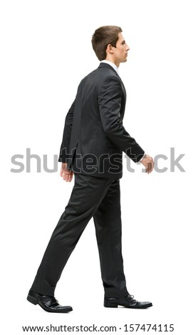 Full-length profile of walking business man, isolated on white. Concept of leadership and success - stock photo