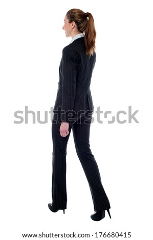 Full-length profile of walking business woman - stock photo