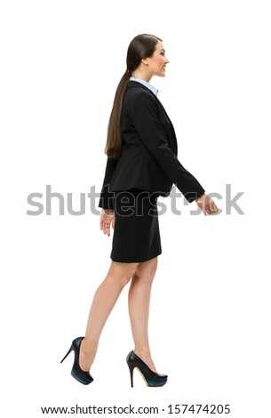 Full-length profile of walking business woman, isolated. Concept of leadership and success - stock photo