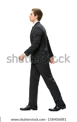 Full-length profile of walking businessman, isolated on white. Concept of leadership and success - stock photo