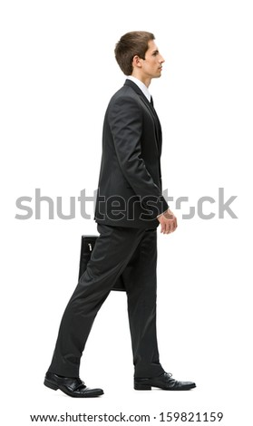 Full-length profile of walking with case businessman, isolated on white. Concept of leadership and success - stock photo