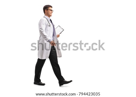 Full length profile shot of a doctor with a clipboard walking isolated on white background