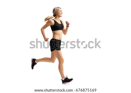 Full length profile shot of a woman running isolated on white background