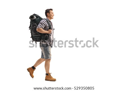 Full length profile shot of a young hiker walking isolated on white background