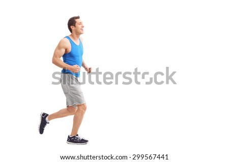 Full length profile shot of a young man in sportswear running and smiling isolated on white background - stock photo