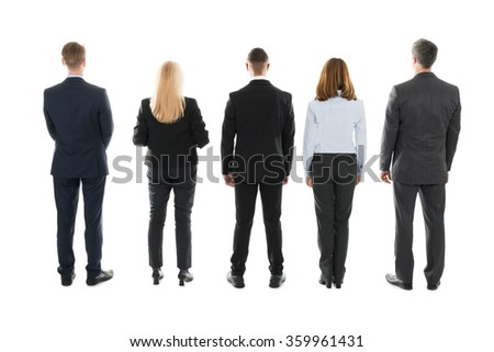 Full length rear view of business people standing against white background - stock photo