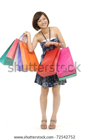 full-length shopping asian girl on white backgrouns - stock photo