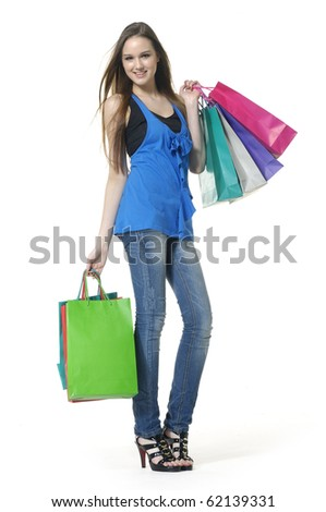 Full length shopping girl posing - stock photo