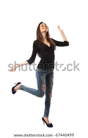 Full length shot of a beautiful hispanic woman in high heels and jeans, isolated on white background
