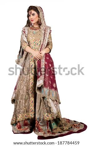 full length shot of a beautiful muslim indian bride - stock photo