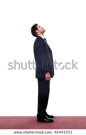 Full length shot of a businessman looking up high. - stock photo