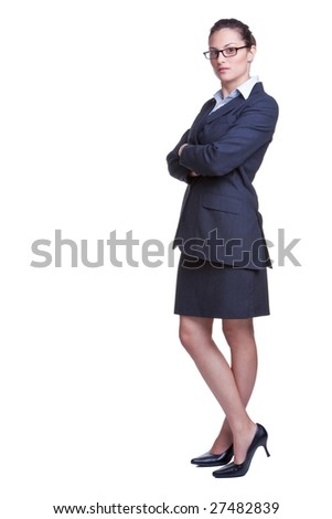 Full length shot of a confident businesswoman dressed in a suit with her arms folded, isolated on white background.