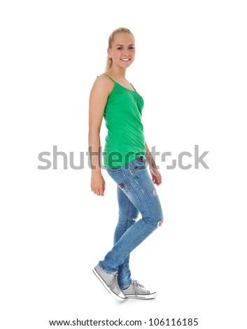 Full length shot of a walking girl. All on white background. - stock photo
