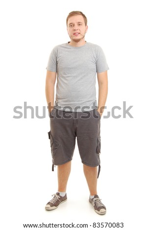 full length shot of a young man in gray shirt, isolated on white - stock photo